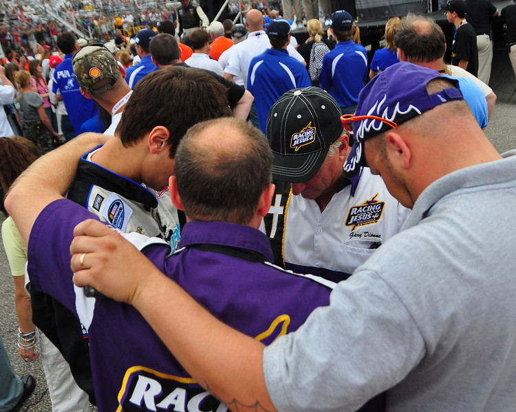 The NASCAR Nationwide Series came to New Hampshire Motor Speedway in Loudon, NH, with the New England 200, on June 26th, 2010. The Racing With Jesus Ministries form a prayer circle, following driver introductions.