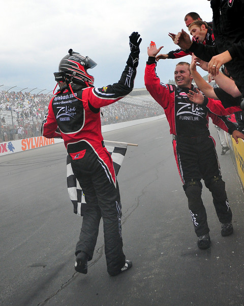 The NASCAR Nationwide Series came to New Hampshire Motor Speedway in Loudon, NH, with the New England 200, on June 26th, 2010, Kyle Busch, driver of the #18 Z-Line/Joe Gibbs Toyota, celebrates with his crew, after taking the checkered flag.