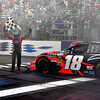 The NASCAR Nationwide Series came to New Hampshire Motor Speedway in Loudon, NH, with the New England 200, on June 26th, 2010. After his 1st place finish, Kyle Busch stopped to claim the checkered flag from the flagman.