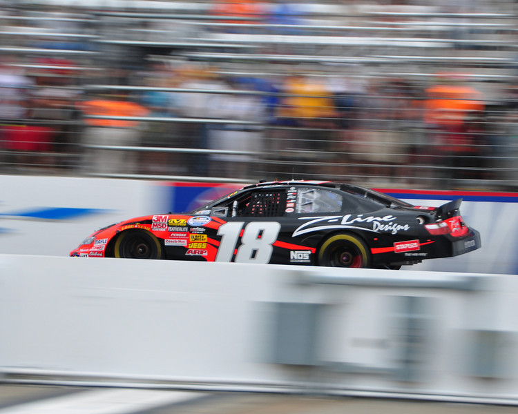 The NASCAR Nationwide Series came to New Hampshire Motor Speedway in Loudon, NH, with the New England 200, on June 26th, 2010. Kyle Busch crosses the finish line to take the win.