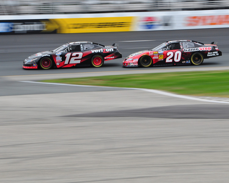 Drivers, Justin Allgaier, #12, and Joey Logano, #20, race through turn 4, during The New England 200, NASCAR Nationwide Series race, at New Hampshire Motor Speedway in Loudon, NH, on June 26th, 2010.