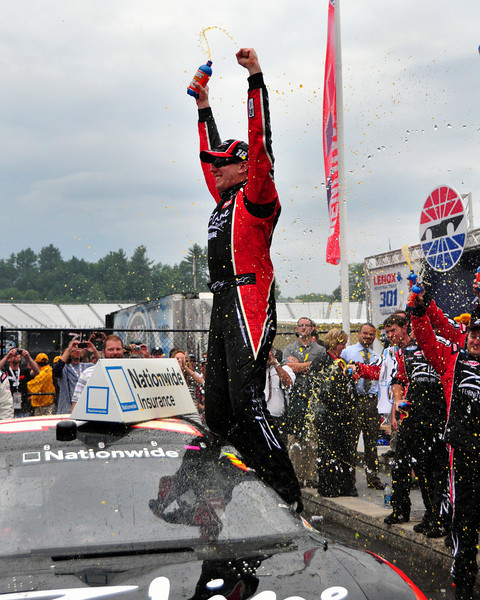 The NASCAR Nationwide Series came to New Hampshire Motor Speedway in Loudon, NH, with the New England 200, on June 26th, 2010. Kyle Busch celebrates in Victory Lane, after taking the checkered flag.