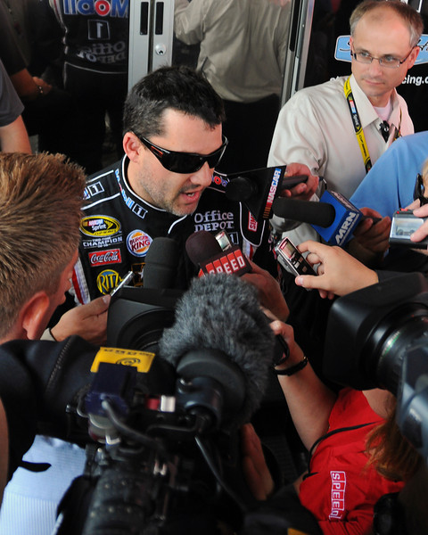 Nascar Sprint Cup Series driver, Tony Stewart, talks with media outside his hauler, on Friday, September 23rd, 2011, in preparation for the Sylvania 300 race, held on September 24th, at New Hampshire Motor Speedway, in Loudon, NH.