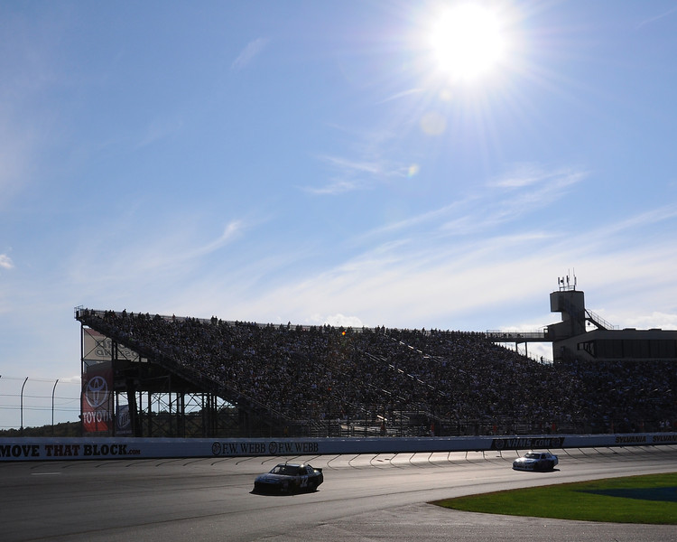 The late afternoon sun shines over New Hampshire Motor Speedway, in Loudon, NH. during the NASCAR Sprint Cup Series, Sylvania 300 race, on September 25th, 2011.