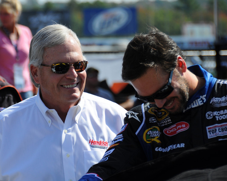Hendrick Motorsports car owner, Rick Hendrick (left), enjoys a happy moment with his NASCAR Sprint Cup Series five time champion driver, Jimmie Johnson, prior to the start of The Sylvania 300, at New Hampshire Motor Speedway, in Loudon, NH. on September 25th, 2011.