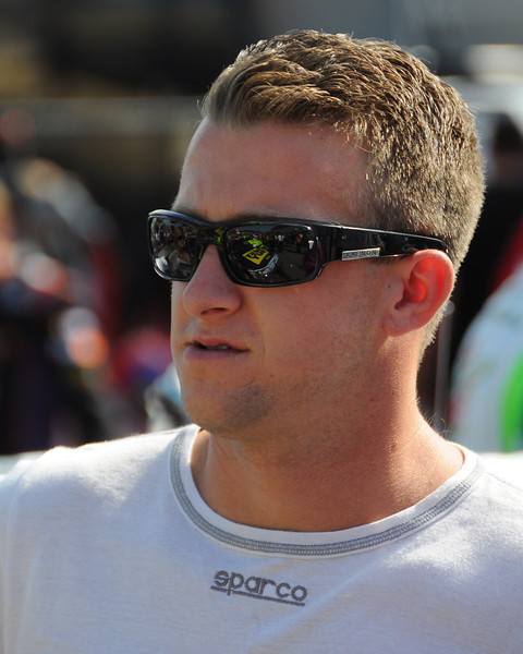 NASCAR Sprint Cup Series driver, A.J. Allmendinger, waits for the National Anthem to begin, prior to the start of The Sylvania 300, at New Hampshire Motor Speedway, in Loudon, NH. on September 25th, 2011.
