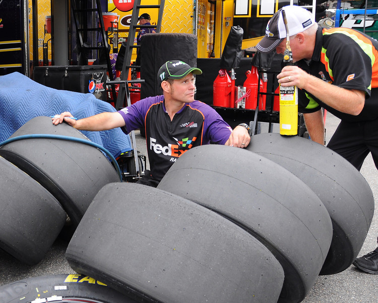 Crew members of NASCAR Sprint Cup Series driver, Denny Hamlin, examine tires after a practice session, on Friday, September 23rd, 2011, for The Sylvania 300, which was run on September 25th, at New Hampshire Motor Speedway, in Loudon, NH.