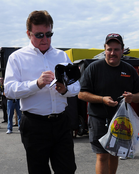 NASCAR Sprint Cup Series car owner, Richard Childress, signs an autograph for a fan, prior to The Sylvania 300, at New Hampshire Motor Speedway, in Loudon, NH. on September 25th, 2011.