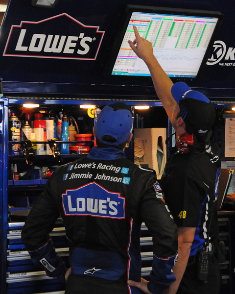 Nascar Sprint Cup Series driver Jimmie Johnson, and Crew Chief Chad Knaus, go over some data, during a practice session, on Friday, September 23rd, 2011, in preparation for the Sylvania 300 race, held on September 25th, at New Hampshire Motor Speedway, in Loudon, NH.