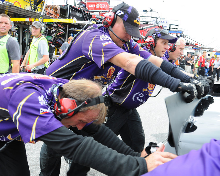 The crew of Nascar Sprint Cup Series driver, Matt Kenseth, pushes his car into the garage for adjustments, during a practice session, on Friday, September 23rd, 2011, in preparation for the Sylvania 300 race, held on September 25th, at New Hampshire Motor Speedway, in Loudon, NH.