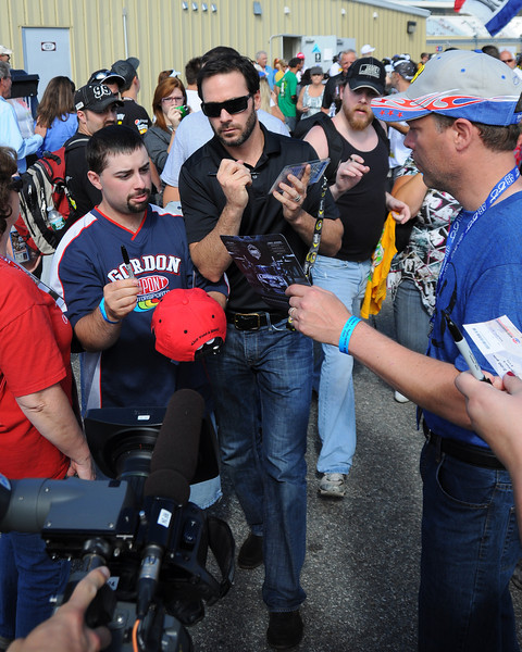 NASCAR Sprint Cup Series five time champion driver, Jimmie Johnson, signs autographs on his way to the drivers meeting for The Sylvania 300, at New Hampshire Motor Speedway, in Loudon, NH. on September 25th, 2011.