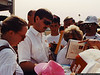 Pocono, July 1992 - Davey Allison signs autographs after Mass on pit road Sunday morning.