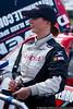 Driver Jennifer Jo Cobb signs an autograph for a fan