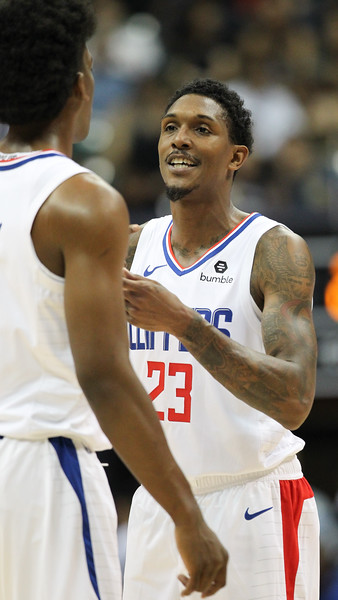 Clippers guard Lou Williams has some words for a teammate during a preseason game against the Houston Rockets on October 3, 2019, at the Stan Sheriff Center in Honolulu, Hawaii.