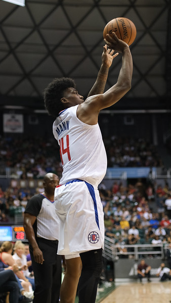 Terance Mann shoots a corner three in a preseason game against the Houston Rockets on October 3, 2019, at the Stan Sheriff Center in Honolulu, Hawaii.