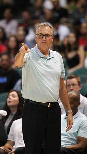 Rockets coach Mike D'Antoni extends his index finger during a preseason game against the Los Angeles Clippers on October 3, 2019, at the Stan Sheriff Center in Honolulu, Hawaii.