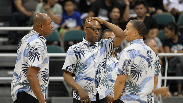 Clippers coaches (l-r) Doc Rivers, Sam Cassell, and Tyronn Lue discuss matters during a preseason game against the Houston Rockets on October 3, 2019, at the Stan Sheriff Center in Honolulu, Hawaii.
