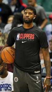 Clippers forward Paul George warms up before a preseason game against the Houston Rockets on October 3, 2019, at the Stan Sheriff Center in Honolulu, Hawaii.