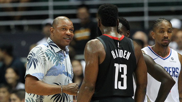Clippers coach Doc Rivers addresses James Harden during a preseason game against the Houston Rockets on October 3, 2019, at the Stan Sheriff Center in Honolulu, Hawaii.