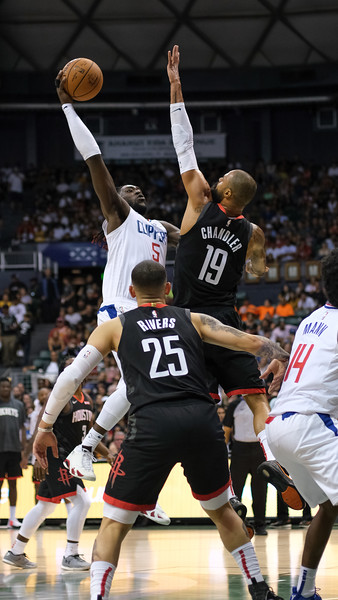 Montrezl Harrell goes up strong against Tyson Chandler during a preseason game against the Houston Rockets on October 3, 2019, at the Stan Sheriff Center in Honolulu, Hawaii.