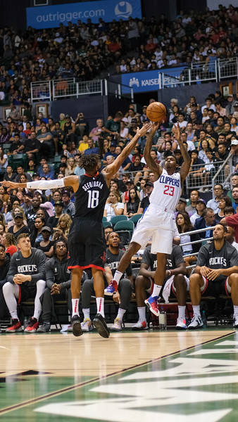 Clippers guard Lou Williams shoots over Rockets' forward Thabo Sefolosha in a preseason game against the Houston Rockets on October 3, 2019, at the Stan Sheriff Center in Honolulu, Hawaii.