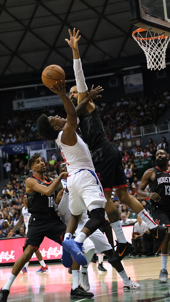 Rockets center Tyson Chandler defends a shot by Clippers guard Terance Mann in a preseason game against the Los Angeles Clippers on October 3, 2019, at the Stan Sheriff Center in Honolulu, Hawaii.