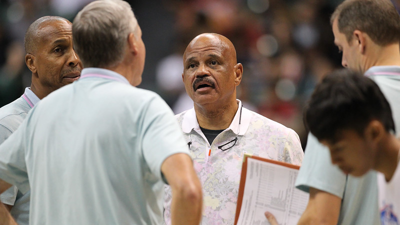 Rockets assistant coach John Lucas addresses head coach Mike D'Antoni during a timeout in a preseason game on October 3, 2019, at the Stan Sheriff Center in Honolulu, Hawaii.