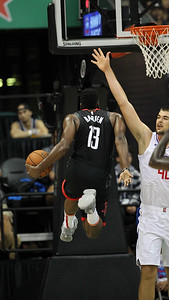Harden hangs for a lefty layup in a preseason game against the Los Angeles Clippers on October 3, 2019, at the Stan Sheriff Center in Honolulu, Hawaii.