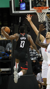 James Harden glides in for a lefty layup as Ivica Zubac defends during a preseason game against the Los Angeles Clippers on October 3, 2019, at the Stan Sheriff Center in Honolulu, Hawaii.