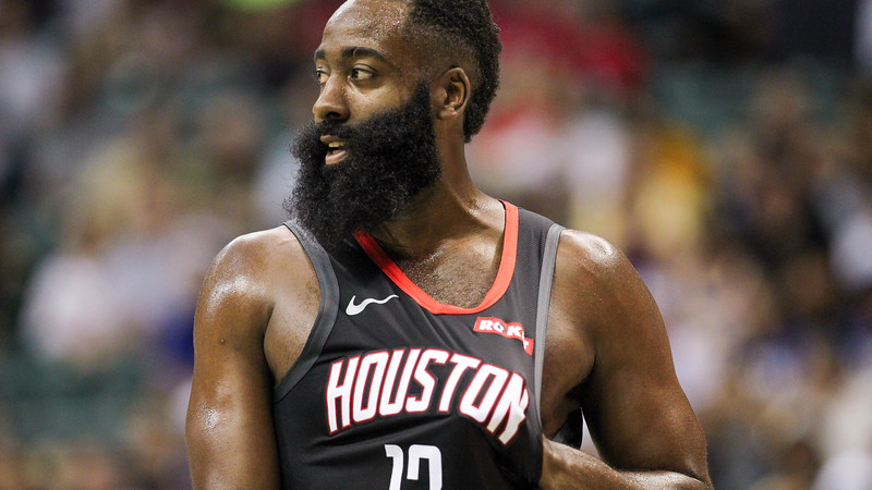 Rockets guard James Harden rubs his chest during a preseason game against the Los Angeles Clippers on October 3, 2019, at the Stan Sheriff Center in Honolulu, Hawaii.