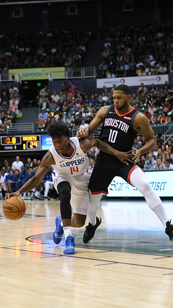 Clippers guard Terance Mann tries to drive on Rockets guard Eric Gordon in a preseason game against the Houston Rockets on October 3, 2019, at the Stan Sheriff Center in Honolulu, Hawaii.
