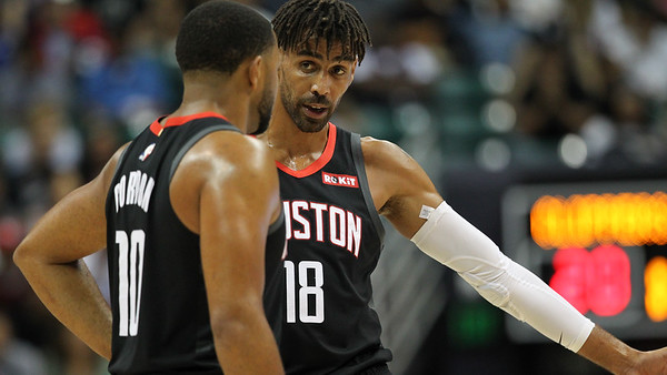 Thabo Sefolosha (18) and Eric Gordon (10) of the Houston Rockets talk during a preseason game against the Los Angeles Clippers on October 3, 2019, at the Stan Sheriff Center in Honolulu, Hawaii.
