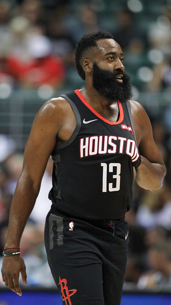James Harden puts his hand under his jersey during a preseason game against the Los Angeles Clippers on October 3, 2019, at the Stan Sheriff Center in Honolulu, Hawaii.