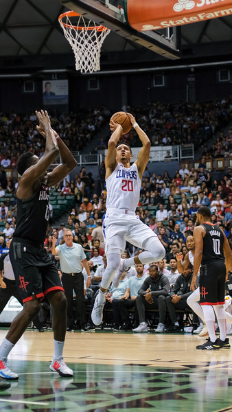 Clippers guard Landry Shamet shoots a runner in a preseason game against the Houston Rockets on October 3, 2019, at the Stan Sheriff Center in Honolulu, Hawaii.