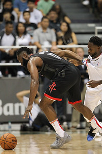 Houston Rockets guard James Harden grabs Los Angeles Clippers guard Patrick Beverley's jersey while going after a loose ball during a preseason game against the Los Angeles Clippers on October 3, 2019, at the Stan Sheriff Center in Honolulu, Hawaii.