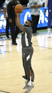 Rockets guard James Harden shoots before a preseason game against the Los Angeles Clippers on October 3, 2019, at the Stan Sheriff Center in Honolulu, Hawaii.