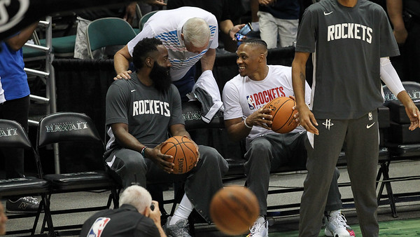 NBA legend Jerry West speaks with James Harden and Russell Westbrook before a preseason game against the Los Angeles Clippers on October 3, 2019, at the Stan Sheriff Center in Honolulu, Hawaii.