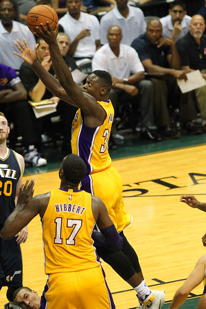 Julius Randle (30) of the Lakers goes up with the left hand during an NBA preseason game against the Jazz at the Stan Sheriff Center, Honolulu, HI on October 04, 2015.