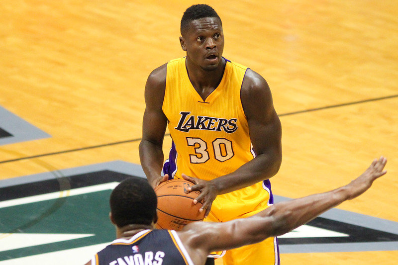 Lakers forward Julius Randle (30) looks to shoot over Jazz forward Derrick Favors (15) during an NBA preseason game at the Stan Sheriff Center, Honolulu, HI on October 04, 2015.