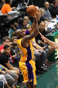 Kobe Bryant (24) of the Lakers shoots over a Jazz defender in an NBA preseason game at the Stan Sheriff Center, Honolulu, HI on October 04, 2015.