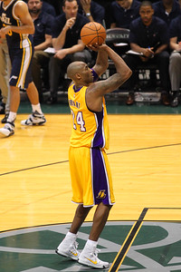 Kobe Bryant (24) shoots a free throw in an NBA preseason game against the Utah Jazz at the Stan Sheriff Center, Honolulu, HI on October 04, 2015.