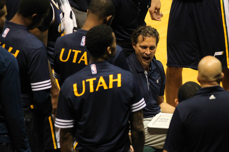 Jazz head coach Quin Snyder speaks to the team during a time out during an NBA preseason game against the Lakers at the Stan Sheriff Center, Honolulu, HI on October 04, 2015.