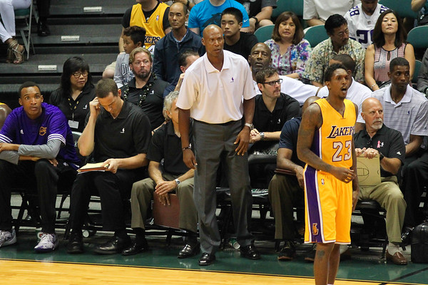 Head coach Byron Scott of the Los Angeles Lakers gets up off the bench in an NBA preseason game against the Utah Jazz at the Stan Sheriff Center, Honolulu, HI on October 04, 2015.