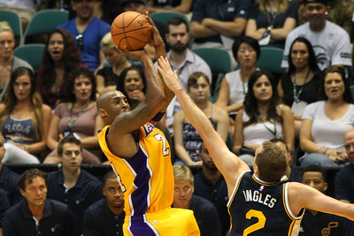 Kobe Bryant (24) of the Los Angeles Lakers shoots over Utah Jazz forward Joe Ingles (2) during an NBA preseason game at the Stan Sheriff Center, Honolulu, HI on October 04, 2015.