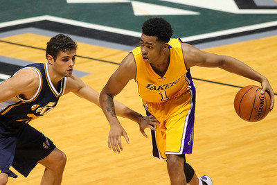 Lakers guard D'Angelo Russell (1) dribbles against Jazz guard Raul Neto (25) during an NBA preseason game at the Stan Sheriff Center, Honolulu, HI on October 04, 2015.
