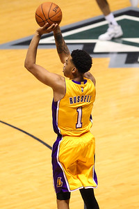 Lakers rookie D'Angelo Russell (1) shoots a three pointer against the Jazz during an NBA preseason game at the Stan Sheriff Center, Honolulu, HI on October 04, 2015.