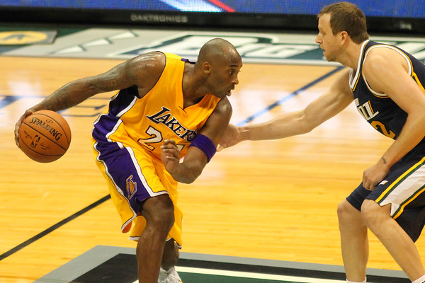Kobe Bryant (24) of the Los Angeles Lakers looks to drive on Utah Jazz forward Joe Ingles (2) during an NBA preseason game at the Stan Sheriff Center, Honolulu, HI on October 04, 2015.