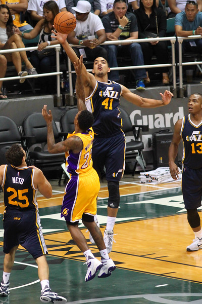 Trey Lyles (41) of the Jazz contests the floater of Lou Williams (23) of the Lakers during an NBA preseason game at the Stan Sheriff Center, Honolulu, HI on October 04, 2015.