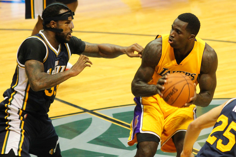 Brandon Bass (2) of the Los Angeles Lakers pump fakes against Utah Jazz defender Trevor Booker (33) during an NBA preseason game at the Stan Sheriff Center, Honolulu, HI on October 04, 2015.