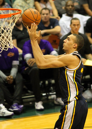 Utah Jazz center Rudy Gobert (27) rises to the rim during an NBA preseason game against the Los Angeles Lakers at the Stan Sheriff Center, Honolulu, HI on October 04, 2015.